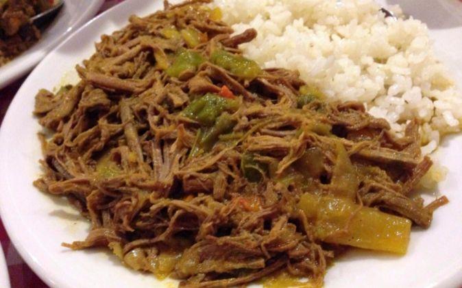 La ropa vieja con arroz blanco es el plato típico cubano por...