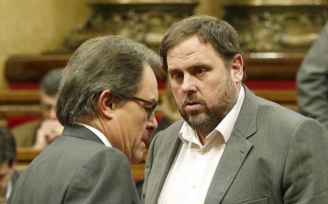 El president de la Generalitat, Artur Mas, y el líder de ERC, Oriol...