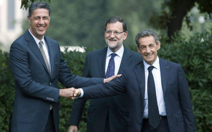 Raúl Albiol, Mariano Rajoy y Nicolas Sarkozy.