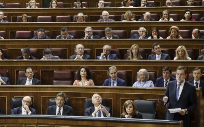 El presidente del Gobierno en funciones, Mariano Rajoy, durante su...