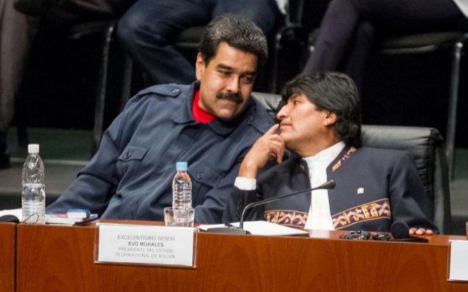 El presidente de Venezuela, Nicolás Maduro, y el presidente de...