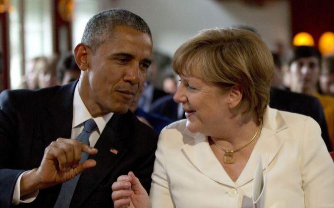 El presidente de EEUU, Barack Obama, y su homologa alemana, Angela...