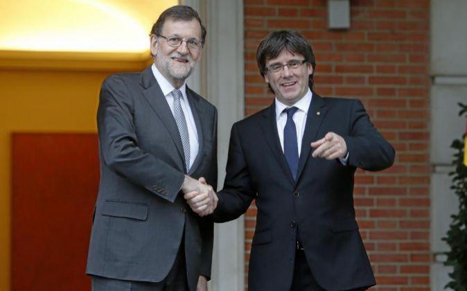 Mariano Rajoy con el Presidente de la Generalitat Carles Puigdemont.