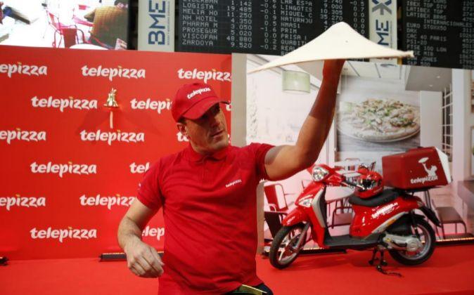 Imagen de la salida a Bolsa, ayer, de Telepizza