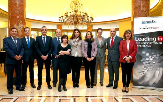 De izda. a dcha: Manuel del Pozo, director adjunto de Expansión;...