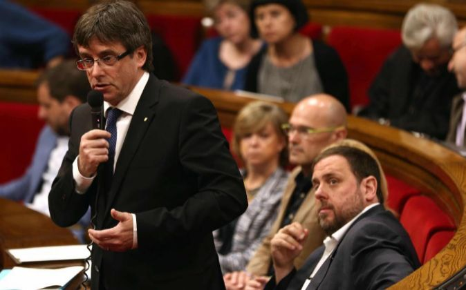 El presidente de la Generalitat, Carles Puigdemont, durante una...
