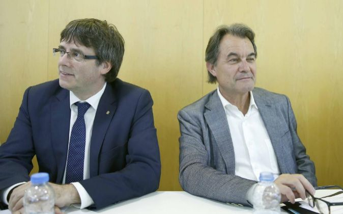 El presidente de CDC, Artur Mas (d), junto al president de la...
