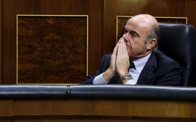 El ministro de Economía en funciones, Luis de Guindos, ayer durante...