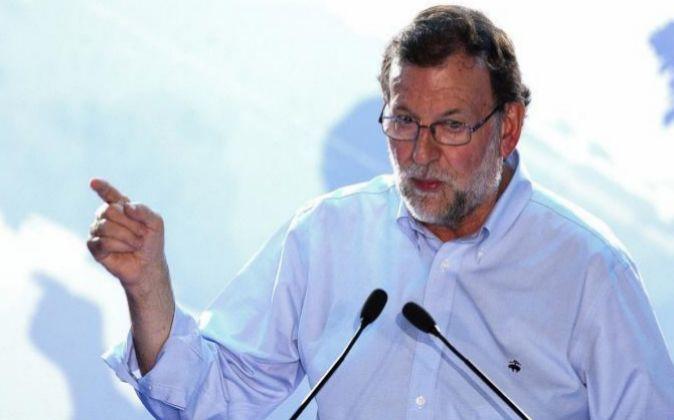 El presidente del PP y del Gobierno en funciones, Mariano Rajoy, en un...