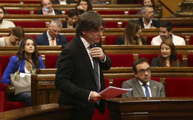 El president de la Generalitat, Carles Puigdemont, antes de su...