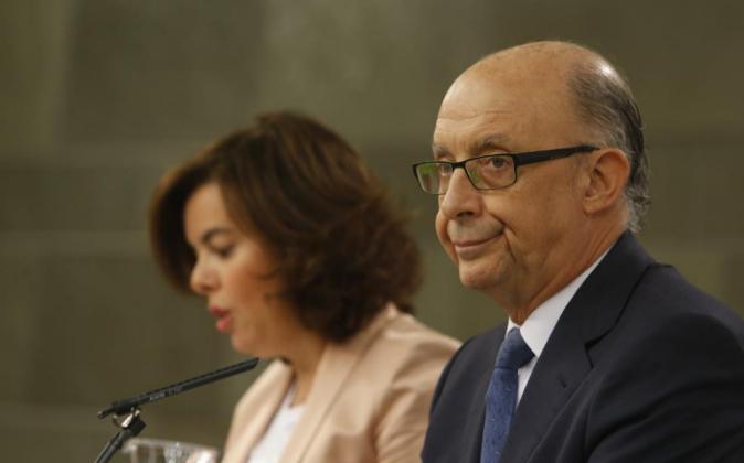 Cristóbal Montoro y Soraya Sáenz de Santamaría, tras el Consejo de...