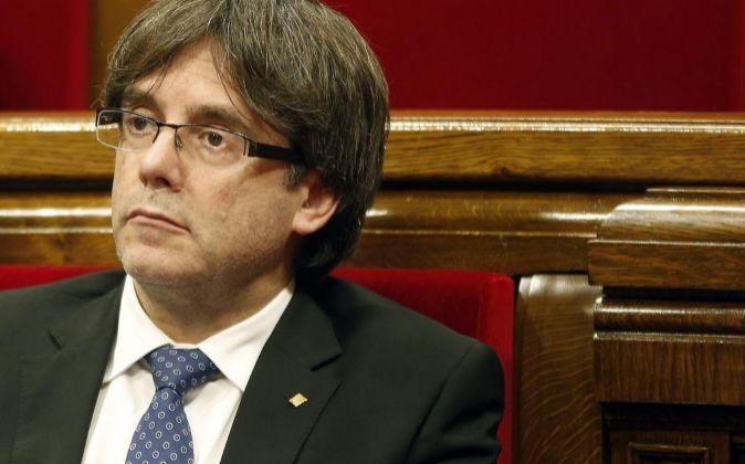 El presidente de la Generalitat, Carles Puigdemont, durante el debate...