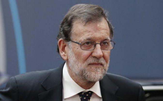 El presidente en funciones, Mariano Rajoy, a su llegada a la cumbre de...