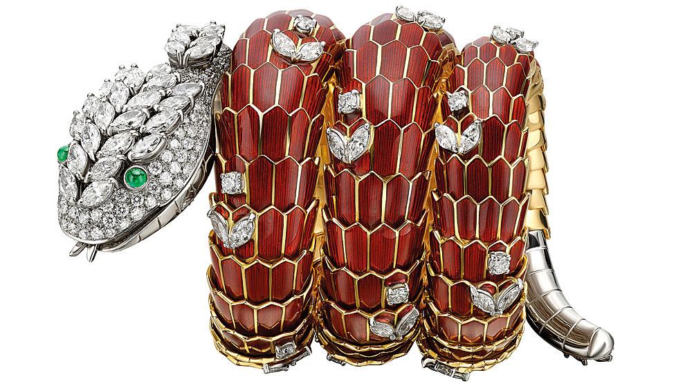 Reloj joya de oro, con esmalte rojo, esmeraldas y diamantes, de 1965...