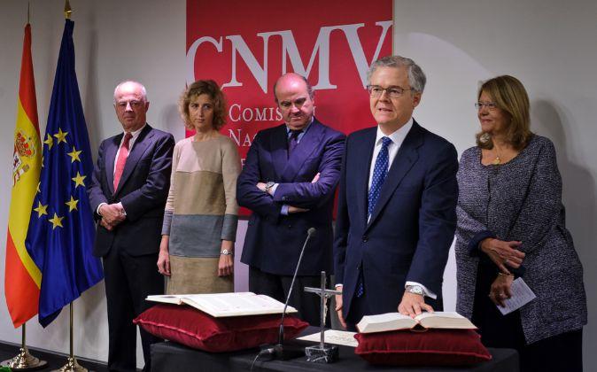 De izda a dcha, el expresidente en funciones, Juan Manuel...