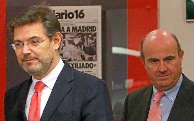 Rafael Catalá y Luis de Guindos, ministros de Justicia y Economía.
