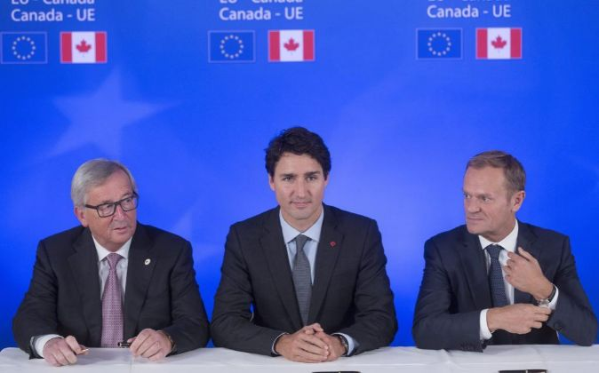 Jean-Claude Juncker, Justin Trudeau y Donald Tusk.