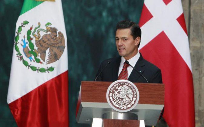 El presidente de México Enrique Peña Nieto en una una rueda de...