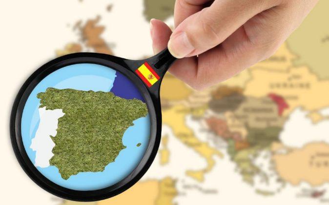 Mapa de España con una lupa.