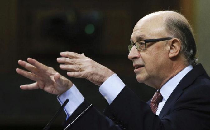 El ministro de Hacienda, Cristóbal Montoro, hoy durante su...