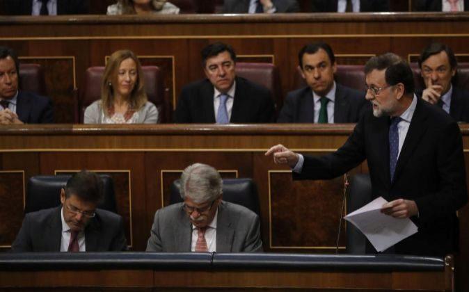 El presidente del Gobierno, Mariano Rajoy, durante su intervención en...