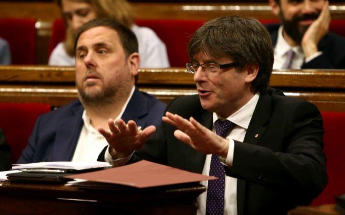 Oriol Junqueras y Carles Puigdemont, la semana pasada en el Parlament.