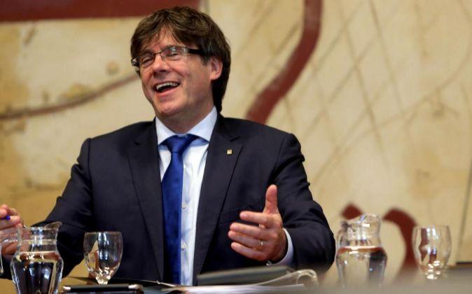 El presidente de la Generalitat, Carles Puigdemont, durante la...