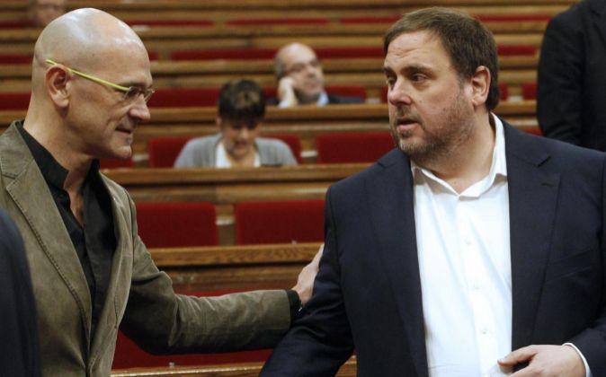 El conseller Raül Romeva junto al vicepresidente Oriol Junqueras.