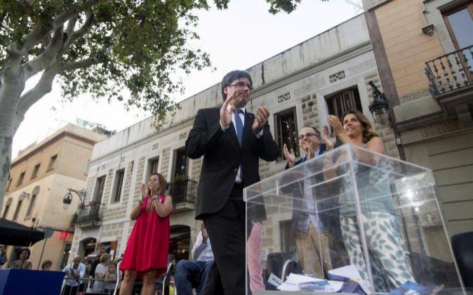 El presidente de la Generalitat, Carles Puigdemont durante el acto de...