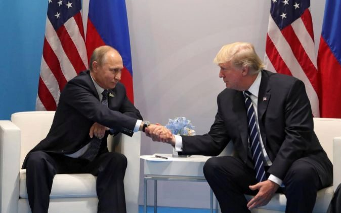 Vladimir Putin junto a Donald Trump.