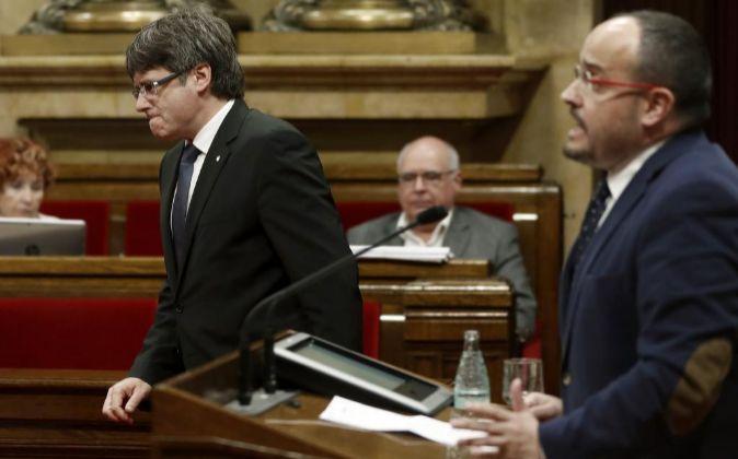 El presidente de la Generalitat, Carles Puigdemont y el portavoz del...