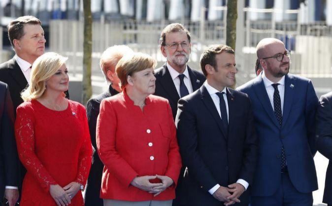 Angela Merkel, Mariano Rajoy y Emmanuel Macron, junto a otros...