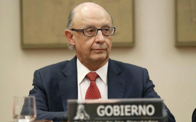El ministro de Hacienda, Cristóbal Montoro, durante su comparecencia...