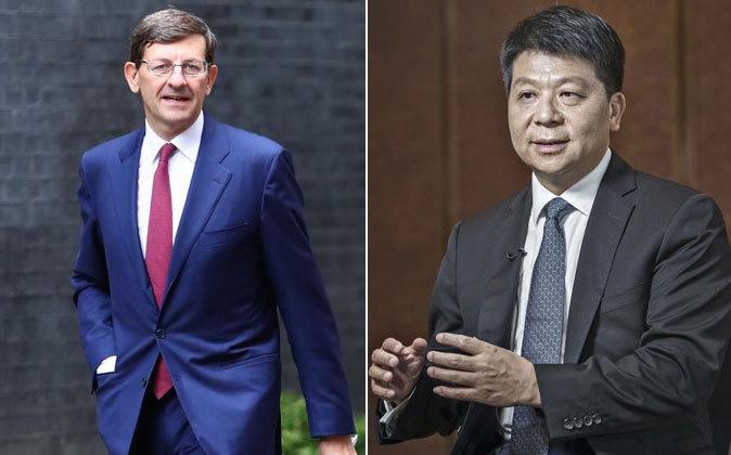 Vittorio Colao, consejero delegado del grupo Vodafone, y Guo Ping, CEO...