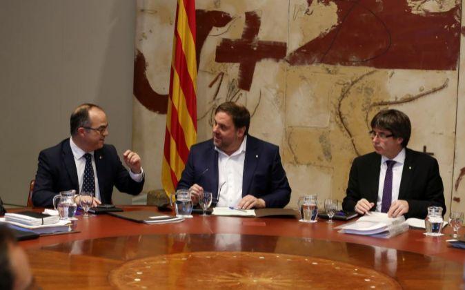 De izquierda a derecha: Jordi Turull, conseller de Presidencia y...