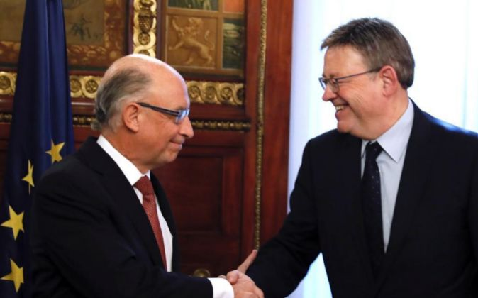 Cristóbal Montoro y Ximo Puig, en una reunión celebrada el mes...