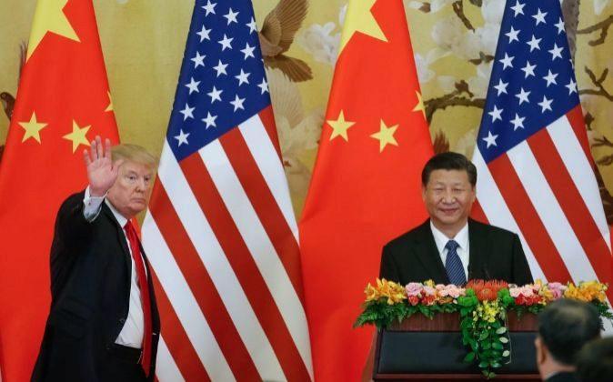 El presidente de EEUU, Donald Trump, y su homólogo chino, Xi...