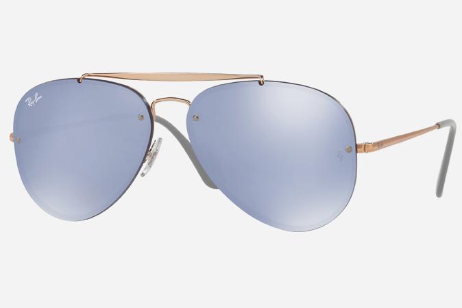 cb52430ef9 Gafas de sol Aviator con cristal azulado de la marca Ray-Ban.