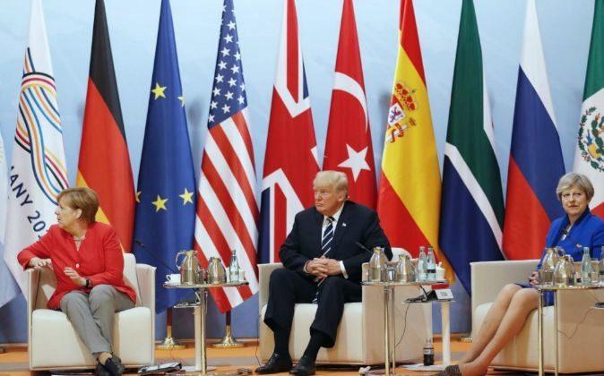 La canciller alemana, Angela Merkel, el presidente estadounidense,...