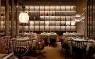 La decoración del restaurante recrea un bosque de álamos.