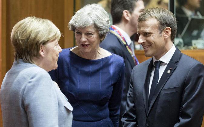 Emmanuel Macron, Theresa May y Angela Merkel en Bruselas la semana...