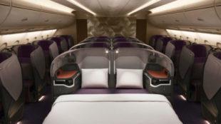 Cama de dos metros en Singapore Airlines, con sábanas de lino.