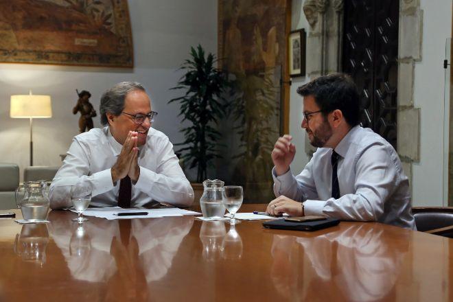 El presidente de la Generalitat, Quim Torra (JxCat), y el número dos...