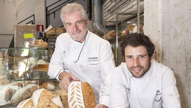 Los panaderos Javier Cocheteux padre e hijo, rodeados de sus panes artesanos, en el local de Pan.Delirio. de Juan Bravo, en Madrid.