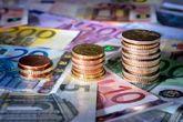 Imagen de billetes y monedas de euro