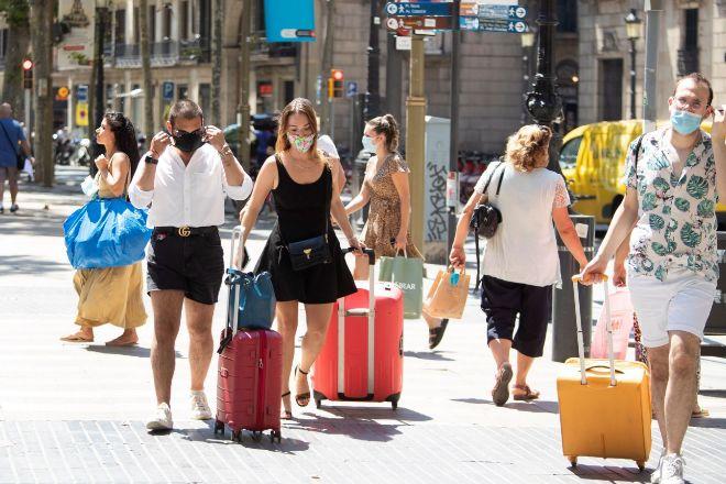 Turistas en las Ramblas de Barcelona.