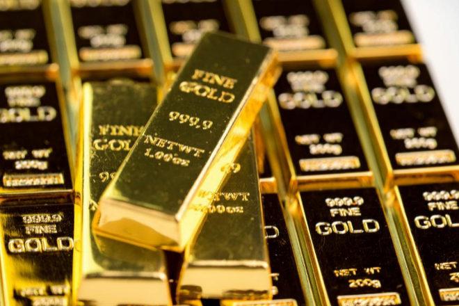 El oro pulveriza los 2.000 dólares y sube un 32% en 2020