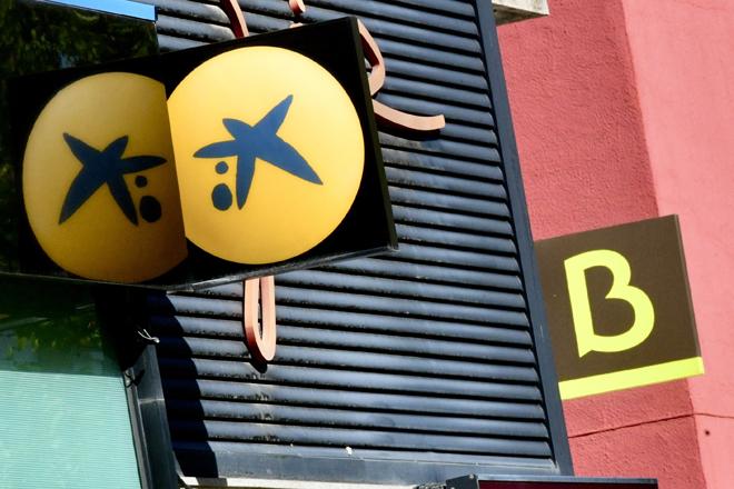 Oficinas de CaixaBank y Bankia, protagonistas de la última gran fusión de la banca española.