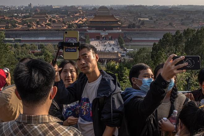 El ritmo de recuperación en China es enormemente importante para la economía global. En la imagen, turistas en la Ciudad Prohibida en Pekín esta semana.