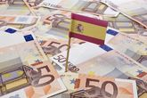 Bandera de España sobre billetes de euro
